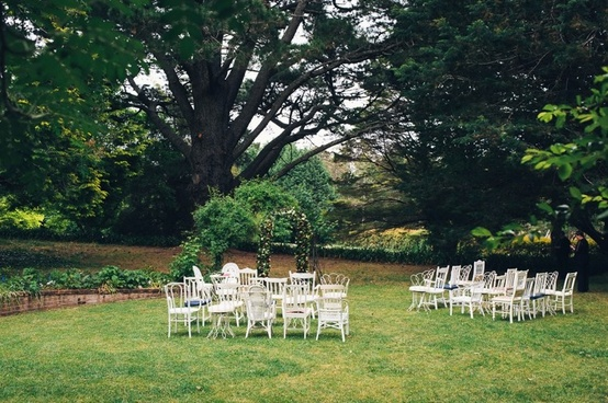 white vintage wedding ceremony chairs