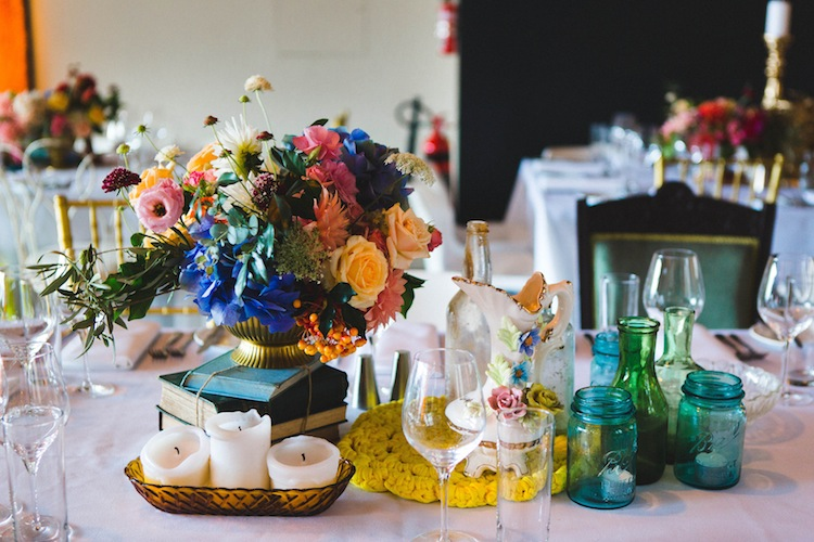 colourful table styling with flowers and jars