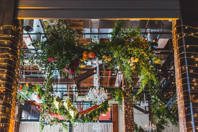 hanging flowers from roof and fairy lights